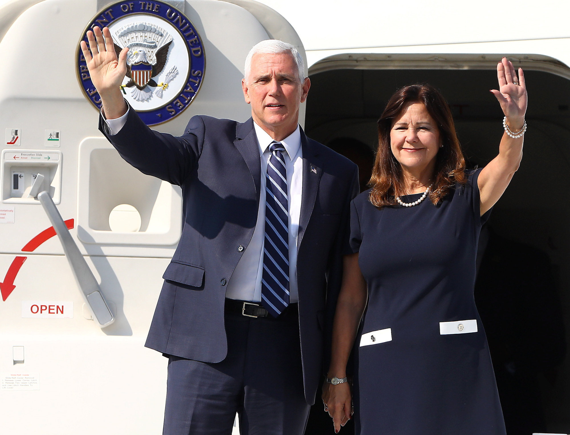 epa07809259 US Vice-President Mike Pence (L) and and his wife Karen Pence wave after arriving at Okecie Airport to the ceremony marking 80th anniversary of World War II outbreakin in Warsaw, Poland, 01 September 2019. Pence represent US President Donald Trump, who has had to postpone his visit planned for 01-02 September, explaining that all federal government resources need to be focused on the incoming hurricane Dorian.  EPA-EFE/Rafal Guz POLAND OUT
