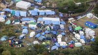 epa04982892 Aerial view of the makeshift migrant camp the 'Jungle', in Calais, France, 18 October 2015. More than 3,000 migrants live in the camp according to associations and non-governmental organizations (NGOs), waiting for a chance to cross