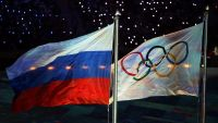 epa05023809 (FILE) A file picture dated 23 February 2014 of the Olympic flag (R) and the Russian flag (L) during the Closing Ceremony of the Sochi 2014 Olympic Games in the Fisht Olympic Stadium in Sochi, Russia. Athletics ruling body IAAF on 13 November