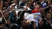 epa05034153 Palestinians carry the body of 24-years-old Shadi Arafeh who was reportedly killed in a shooting attack on an Israeli car in the West Bank, during his funeral in the West Bank city of Hebron, 20 November 2015. According to reports, three
