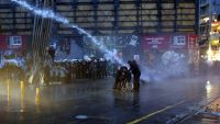 epa05046117 Turkish riot policemen use water cannon to disperse the crowd during a protest against the killing of Tahir Elci, the head of the local chamber of lawyers, who was killed during a demonstration in Diyarbakir, downtown Istanbul, Turkey, 28