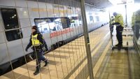epa05086872 Police mounts a temporary fence to ease border control preventing illegal migrants to enter Sweden, between domestic and international tracks at Hyllie train station in southern Malmo, Sweden, 03 January 2016. The station is the first stop