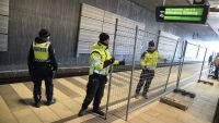 epa05086874 Police mounts a temporary fence to ease border control preventing illegal migrants to enter Sweden, between domestic and international tracks at Hyllie train station in southern Malmo, Sweden, 03 January 2016. The station is the first stop