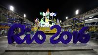 epa05148957 Participants push a Rio 2016 Olympics sign during the opening ceremony presenting the Samba Schools' parade at the Sambodromo of Rio de Janeiro in Rio de Janeiro, Brazil, 07 February 2016.  EPA/MARCELO SAYAO