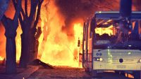 epa05166818 Flames engulf vehicles following a car bomb detonation close to buildings of the Turkish military in Ankara, capital of Turkey, 17 February 2016. At least 18 people were killed and another 61 were injured in the attack, Ankara governor Mehmet