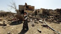epa05179929 A child walks past her family's house that was destroyed by a Saudi-led airstrike at a neighborhood in Sana'a, Yemen, 25 February 2016. According to reports, the Saudi-led coalition stepped up its airstrikes on Sana'a, killing