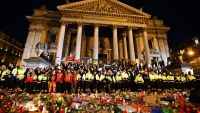 epa05231002 Emergency services observe a minute of silence to the people killed and injured in the 22 March Brussels terrorist attacks, at Place de la Bourse, in Brussels, Belgium, 25 March 2016. At least 31 people were killed with hundreds injured in