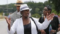Leolah Brown talks with media members outside the church hosting a funeral service for her brother Bobby Brown's daughter, Bobbi Kristina Brown, Saturday, Aug. 1, 2015, in Alpharetta, Ga. She said she was angry because Pat Houston was speaking at the