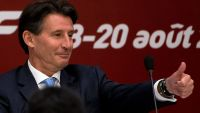 Sebastian Coe, newly elected International Association of Athletics Federations President gestures as he arrives on stage for a press briefing at the IAAF Congress at the National Convention Center in Beijing, Wednesday, Aug. 19, 2015. (AP Photo/Andy Wong