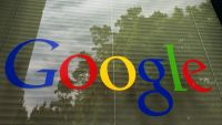 FILE - This Thursday, April 12, 2012 file photo shows a Google logo at the company's headquarters in Mountain View, Calif. According to new rules announced on Friday, June 19, 2015, Google plans to censor unauthorized nude photos from its Internet