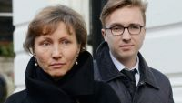 epaselect epa04588561 The widow of Alexander Litvinenko, Marina Litvinenko (L), and her son Anatoly Litvinenko stand outside the Royal Courts of Justice, in London, Britain, 27 January 2015. A public inquiry into the death of poisoned spy Alexander