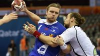 epa04576896 Iceland player Aron Palmarsson (L) in action against Czech Republic player Pavel Horak (R) during the Qatar 2015 men's Handball World Championship 2015 match between Iceland and Czech Republic at the Ali Bin Hamad Al-Attiya Arena at Al