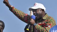epa04746216 (FILE) A file picture dated 24 June 2010 shows President of Burundi Pierre Nkurunziza raising his fist as he delivers a speech at a campaign for the presidential elections 2010 in Bujumbura, Burundi. Major General Godefroid Niyombare seizes