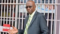 epa04770651 Former FIFA vice president Austin Jack Warner, gestures as he leaves the office of the Sunshine Newspaper which he owns in Arouca, East Trinidad, on May 27, 2015. Warner, who was also the former President of Concacaf, was named among current