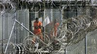 epa03682731 (FILE) A file photograph showing men dressed in orange coveralls, alleged al-Qaida and Taliban combatants captured in Afghanistan washing before midday prayers at controversial Camp X-Ray, where they are being held in cages at the US Naval