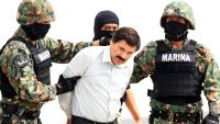 epa04843408 (FILE) A file photograph showing members of the Mexican military holding Mexican drug lord Joaquin Guzman Loera, alias 'El Chapo' (C) at the Navy hangar in Mexico City, Mexico, 22 February 2014. Media reports on 12 July 2015 state
