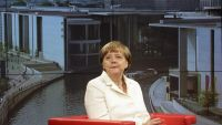 German Chancellor Angela Merkel waits prior to an   interview at the TV  studios of German public broadcaster ARD  in Berlin, Germany, Sunday, July 19, 2015. (AP Photo/Markus Schreiber)