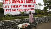 epa04739378 (FILE) A file picture dated 16 October 2014 shows a Liberian man walks past an Ebola information poster as a measure to curb the spread of the Ebola virus in Monrovia, Liberia. Liberia is declared free from Ebola on 09 April 2015 after 42 days