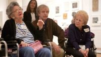 "Arden White, right, listens as Elaine Gold, left,  talks about Pablo Picasso's ""Girl Before a Mirror"" during a guided tour for a group of Alzheimer's patients, Tuesday, April 11, 2006 in New York. ""Meet Me at MoMA"" is a"