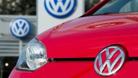 epa04943309 (FILE) A file picture dated 20 February 2014 showing a red Volkswagen in front of a car dealer in Hanover, Germany.  The head of Volkswagen's US division apologized late 21 September 2015 for the German automaker's use of software