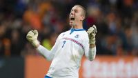 epa04911747 Iceland's goalkeeper Hannes Halldorsson celebrates their victory at the end of the UEFA Euro 2016 qualifying round soccer match between the Netherlands and Iceland at the Arena Stadium, in Amsterdam, The Netherlands, 03 September 2015.
