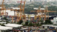 epa04852957 Containers are seen piled at the Port Authority of Thailand, Khlong Toey port in Bangkok, Thailand, 19 July 2015. The Asian Development Bank (ADB) on 16 July lowered its economic growth forecast for developing Asia amid slower than expected