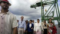 U.S. Commerce Secretary Penny Pritzker, center,  walks with the Directors of Mariel Port Charles Baker, second left and Ana Teresa Igarza, third right, during is visits to the container terminal at the port in the Bay of Mariel, Cuba,Tuesday, Oct. 6, 2015