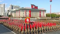 In this image made from video, the portrait of late North Korea's founder Kim Il Sung is held atop during parade marking the 70th anniversary of the country's ruling party in Pyongyang, Saturday, Oct. 10, 2015.  Goose-stepping North Korean