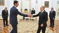 epa04986385 A picture made available on 21 October 2015 shows Russian President Vladimir Putin (R) shaking hands with Syrian President Bashar al-Assad during their meeting at the Kremlin in Moscow, Russia, 20 October 2015. Beleaguered Syrian President
