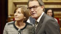 epa04997118 Catalonian acting president, Artur Mas (R), poses next to Member of Parliament Carme Forcadell, of Junts Pel Si party, during the first session of the new regional Parliament in Barcelona, northeastern Spain, 26 October 2015. Forcadell was