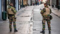 epa05036769 Belgian soldiers patrol in Rue Neuve, the busiest shopping street in Brussels, now empty due to the terror alert level being elevated to 4/4, in Brussels, Belgium, 22 November 2015. Belgium raised the alert status at Level 4/4 as 'serious