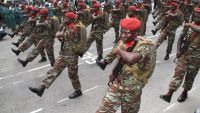 epa04868746 Members of the Army take part in a military parade marking the country?s 55th independence anniversary during the visit of Nigerian President Muhammadu Buhari (not pictured) in Cotonouh, Benin, 01 August 2015. The Nigerian President is on a