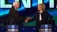 epa04976831 Former US Secretary of State Hillary Clinton (R) and Vermont Senator Bernie Sanders (L) shake hands at the end of the US Democratic Presidential candidates debate at Wynn Las Vegas in Las Vegas, Nevada, USA, 13 October 2015.  EPA/JOSH HANER /