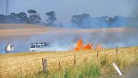 epa05042096 A farmer fights flames in his wheat field near Tarlee, in the mid-north of South Australia, Australia, 26 November 2015. Fires devastated hundreds of hectares of farm land, killing two people and destroying homes.  EPA/BRENTON EDWARDS