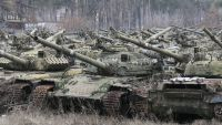 epa05079474 Tanks wait to be repaired at the armored vehicles factory in Kiev, Ukraine, 23 December 2015. The United States a day earlier expanded its list of Russian individuals and entities sanctioned over the Ukraine conflict in an effort to push
