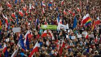 epa05075677 Thousands of city residents attend a demonstration in Poznan, 19 December 2015. People gathered to protest against the newly formed right-wing Law and Justice (PiS) government and its actions aimed at disempowering the Constitutional Tribunal.
