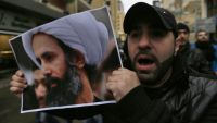 A Lebanese protester holds a picture of the Saudi Shiite cleric Sheikh Nimr al-Nimr during a protest to denounce his execution, in front of the Saudi Arabian embassy in Beirut, Lebanon, Sunday, Jan. 3, 2016. Hassan Nasrallah, the leader of the Lebanese