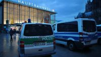 epa05088781 Police vehicles outside the main station in Cologne, Germany, 5 January 2016. Following assaults on women around Cologne's main station at New Year, mayor Henriette Reker held a crisis meeting.  EPA/OLIVER BERG