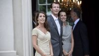 epa04340939 Danish Prince Joachim (C) and his wife Princess Marie (L) along with Danish Environment Minister Kirsten Brosboel (R) host a reception at the Schackenborg Castle in Moegeltoender, Denmark, 04 August 2014, where about 100 guests from home and