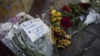 epa05097021 Flowers left by members of the public next to a mural of British singer David Bowie in Brixton, birth place of the late David Bowie in Brixton, London, Britain, 11 January 2016. Well-wishers have flocked to the Bowie mural to pay their