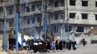 epa05101574 People stand in the besieged town of Madaya, in the countryside of Damascus, Syria, 14 January 2016. Convoys of humanitarian supplies, the second in a week, were on their way to three besieged Syrian towns. Some 44 trucks will enter the rebel