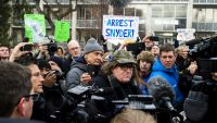 Flint, Mich., native and filmmaker Michael Moore attends a rally outside city hall in Flint, Mich., on Saturday, Jan. 16, 2016, accusing Gov. Rick Snyder of poisoning the city's water. (Jake May/The Flint Journal - MLive.com via AP) LOCAL TELEVISION