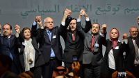 epaselect epa05073187 Libya's Tobruk-based government's representative, Mohammed Chouaib (3 - L),  and Dr. Saleh Almkhozom (3 - R), Second Deputy Chairman of the Libyan General National Congress, celebrate with others after signing a UN