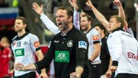 epa05123486 Germany's head coach Dagur Sigurdsson (C) and his players celebrate after winning the EHF European Men's Handball Championship 2016 group 2 match between Germany and Russia at the Centennial Hall in Wroclaw, Poland, 24 January 2016.