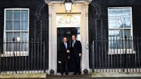 epa05137706 Britain's Prime Minister David Cameron (R) welcomes the President of the European Council, Donald Tusk (L), on the steps of No. 10 Downing Street, in London, Britain, 31 January 2016. EU President Donald Tusk arrived in London on Sunday