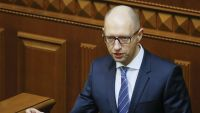 epa05073908 Ukrainian Prime Minister Arseniy Yatsenyuk speaks to lawmakers during a parliament session in Kiev, Ukraine, 17 December 2015. Ukraine has imposed a moratorium against paying back 3 billion dollars that it borrowed from Russia in late 2013,