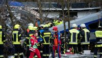 epa05150855 Rescue teams work at the site of a train accident near Bad Aibling, Germany, 09 February 2016. At least four people are dead and another 150 injured after two commuter trains collided head on near the southern German town of Bad Aibling,
