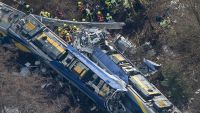 epa05151009 An aerial view of rescue forces working at the site of a train accident near Bad Aibling, Germany, 09 February 2016. At least eight people are dead and another 90 injured after two commuter trains collided head on near the southern German town