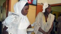 A victim of a suicide bomb attack at a refugee camp receives treatment at a hospital, in Maiduguri, Nigeria, Wednesday, Feb. 10, 2016. Two female suicide bombers blew themselves up in a northeast Nigerian refugee camp, killing at least 56 people, health