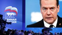 epa05145663 A huge monitor shows Russian Prime Minister Dmitry Medvedev delivering his speech during a congress of the United Russia party in Moscow, Russia, 06 February 2016.  EPA/MAXIM SHIPENKOV